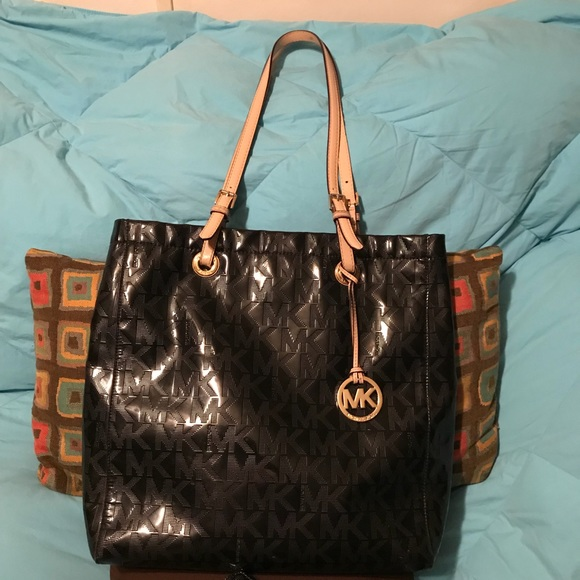 2b9ee2bcaafc ... Black Patent embossed XL JetSet. M 5ad82a1245b30c983fb43ff8. Other Bags  you may like. Michael Kors tote